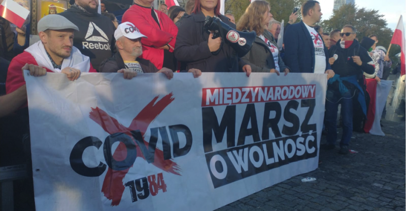 Warsaw police force against 'Stop Covid 1984' campaigners at March for Freedom. Over 200 activists arrested.